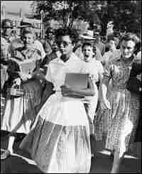 Elizabeth Eckford ignores the hostile screams and stares of adults and fellow students.