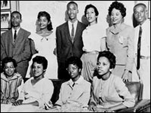 Daisy Bates stands with members of the Little Rock Nine.