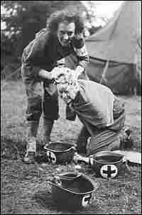 Fellow combat nurse Laura Ball washes Kate Nolan's hair at a field hospital in France in 1944.
