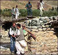 German team members discuss a new bridge to be built in Yawan, Afghanistan.
