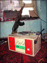 Molavizadeh's burglar alarm is armed with a  Kalashnikov.