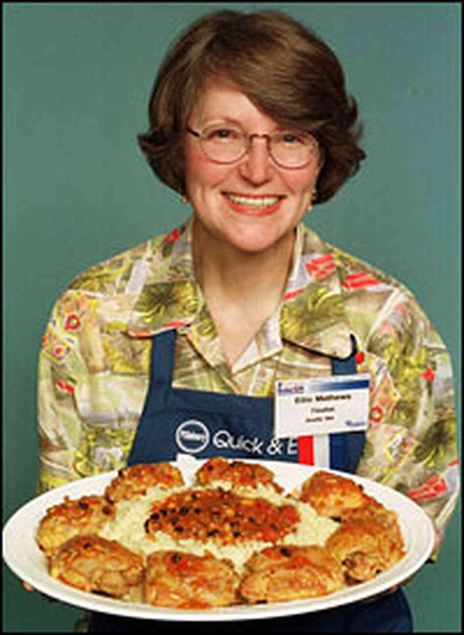 Ellie Mathews holds her winning dish of salsa couscous chicken.