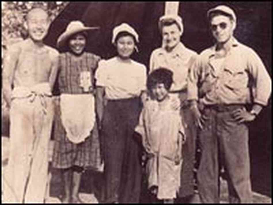 Guy Gabaldon (right) poses in a group that includes Japanese prisoners in 1944.