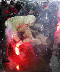 Russian riot police detain an opposition activist during a protest in March.