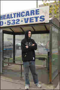 Pettengill waits for the bus outside the VA Medical Center