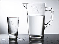 A pitcher and glass of water