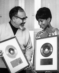 Jerry Wexler and Aretha Franklin proudly display gold records she made with him in the 1960s. [NPR/Michael Ochs Archives/Getty Images]