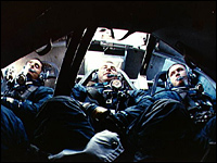The first three humans ever to orbit the moon are shown returning safely to Earth.