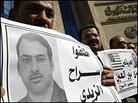 Protesters in Cairo rally on Dec. 18 in support of Iraqi reporter Muntadhar al-Zeidi