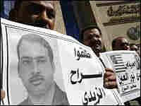Protesters in Cairo rally on Dec. 18 in support of Iraqi reporter Muntadhar al-Zeidi
