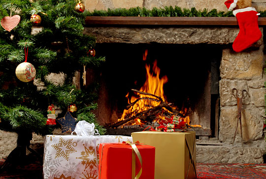 Though experts advise against it, some people toss holiday wrapping paper into a fireplace.