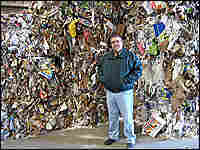 Willimantic's Tim DeVivo stands in front of a pile of mixed paper he can't sell.