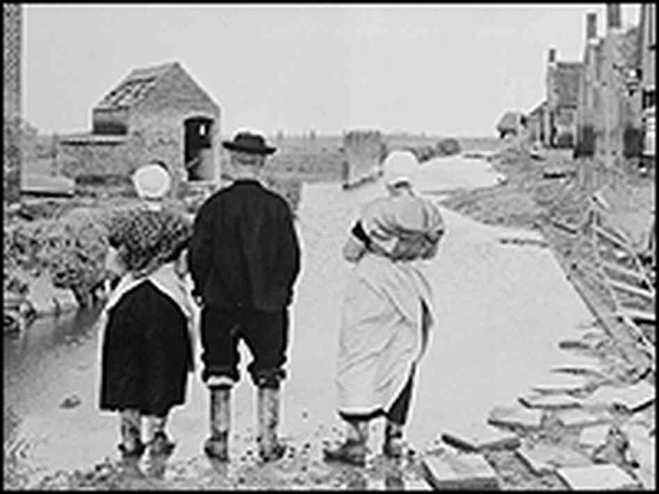 Netherlanders return to their homes after the 1953 flood.