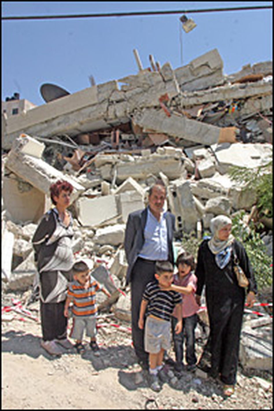 Majid Abu Eesha stands in front of his house, destroyed by Israelis because they say it was expanded without proper permission.