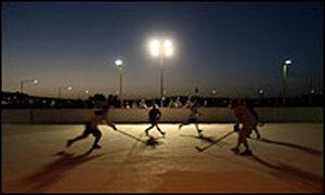 Canadian soldiers playing hockey at Kandahar Air Base