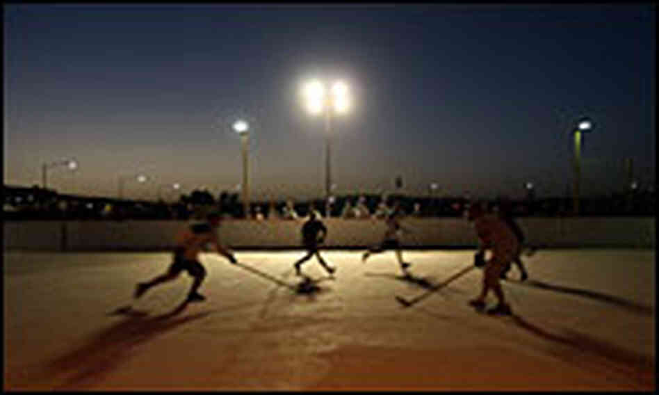 Canadian soldiers playing hockey at Kandahar Air Base