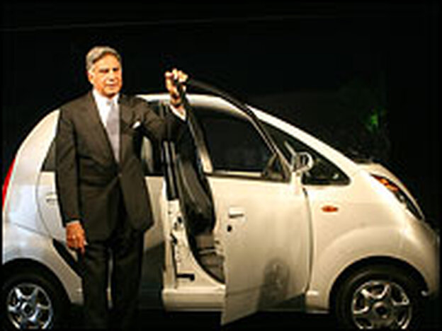 Tata Group Chairman Ratan Tata poses with the Nano, which will be priced at $2,500.
