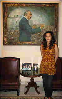 Fatima Bhutto stands in front of a painting of her grandfather, Zulfikar Ali Bhutto.