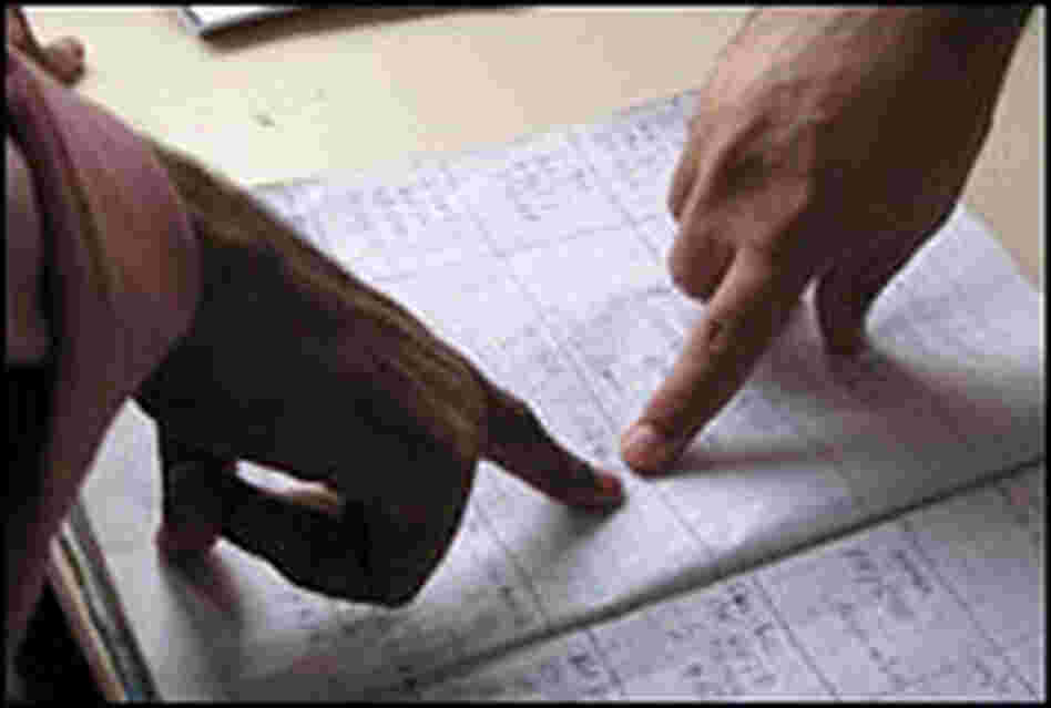 Workers point to log book entries at a command post in Karachi lists recent ambulance calls.