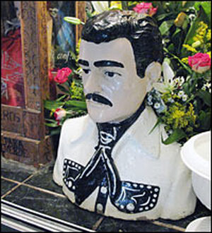"A bust of Jesus Malverde at his shrine in Culiacan, Mexico. Malverde, known as the ""Narco Saint,"" was a local bandit who was killed by authorities in 1909. People say he was a Robin Hood-esque figure who stole from the rich and gave to the poor."