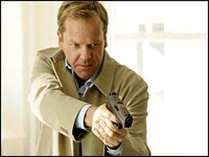 Jack Bauer (Kiefer Sutherland) with gun drawn