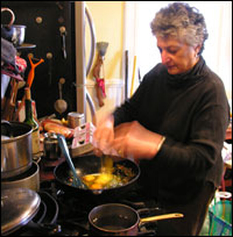 King cooks Parsi eggs in one of three kitchens in her San Francisco home.