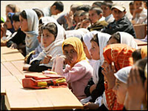 Afghan students listen during an opening ceremony at a school in Kabul in March.
