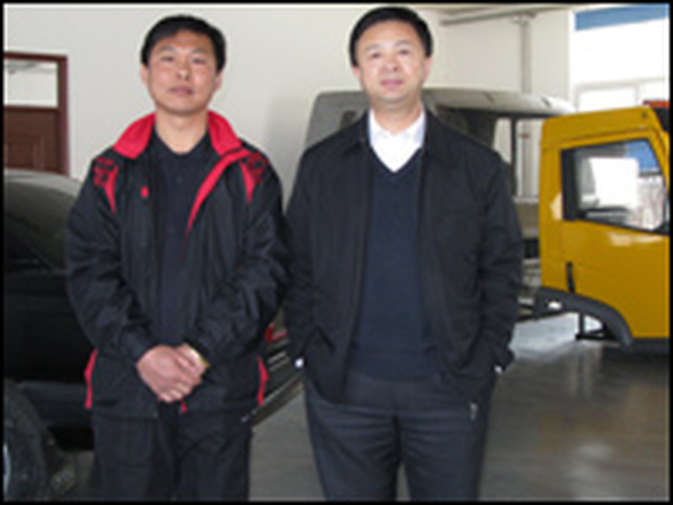 Han Yiaoqiang and Hu Ping are the directors of the auto lab at the Dalian University of Technology. They hope their partnership with SUNY in Morrisville, N.Y., will help them upgrade their program and train car technicians.