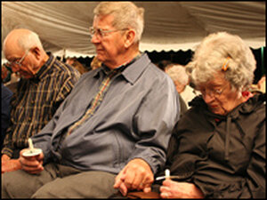 Mourners at a vigil in Greensburg, Kan.