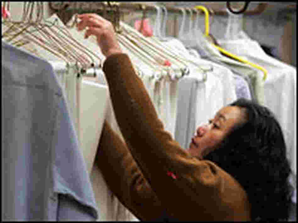 A worker checks a rack at a San Francisco dry cleaner, Jan. 29, 2007.