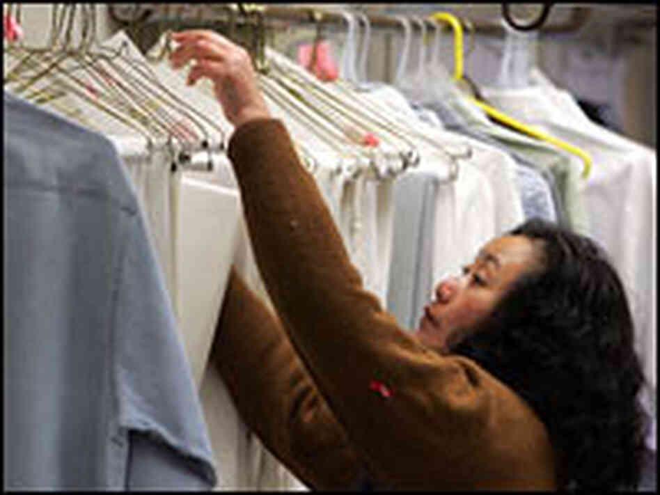 A worker checks a rack at a San Francisco dry cle