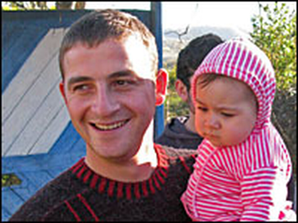 """It was the morning of Aug. 7 — we didn't even have time to eat breakfast,"" says Kevlishvili, shown here with his daughter. ""They put us on buses and told us we were going to South Ossetia."""