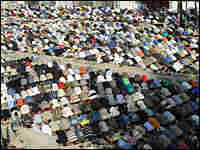 Protesters during Friday prayers in Firdos Square