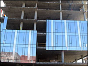 A building under construction in Portland, Ore., will have an energy-efficient glass facade.