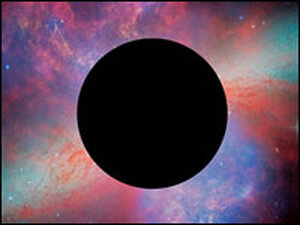 """A """"black hole"""" is superimposed on an image from the Hubble Space Telescope."""