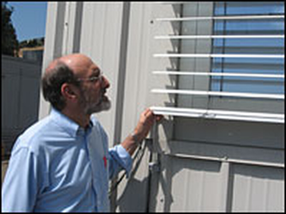 Steve Selkowitz examines the shutters at the window lab at the Department of Energy's Lawrence Berkeley National Laboratory in Berkeley, Calif. Researchers here are working on the next generation of energy-efficient windows.
