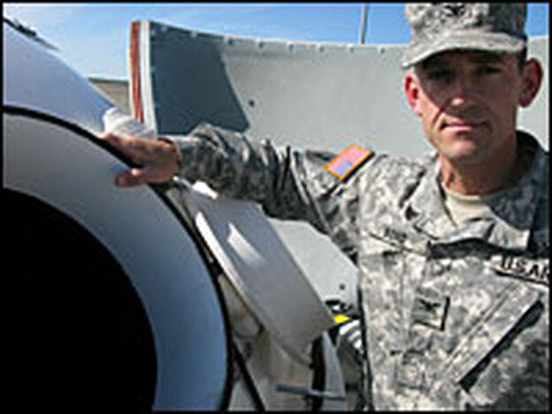 Col. George Bond, the Missile Defense Agency's top officer at Fort Greely, stands beside the open hatch to a silo housing one of some 14 missile interceptors now deployed there.