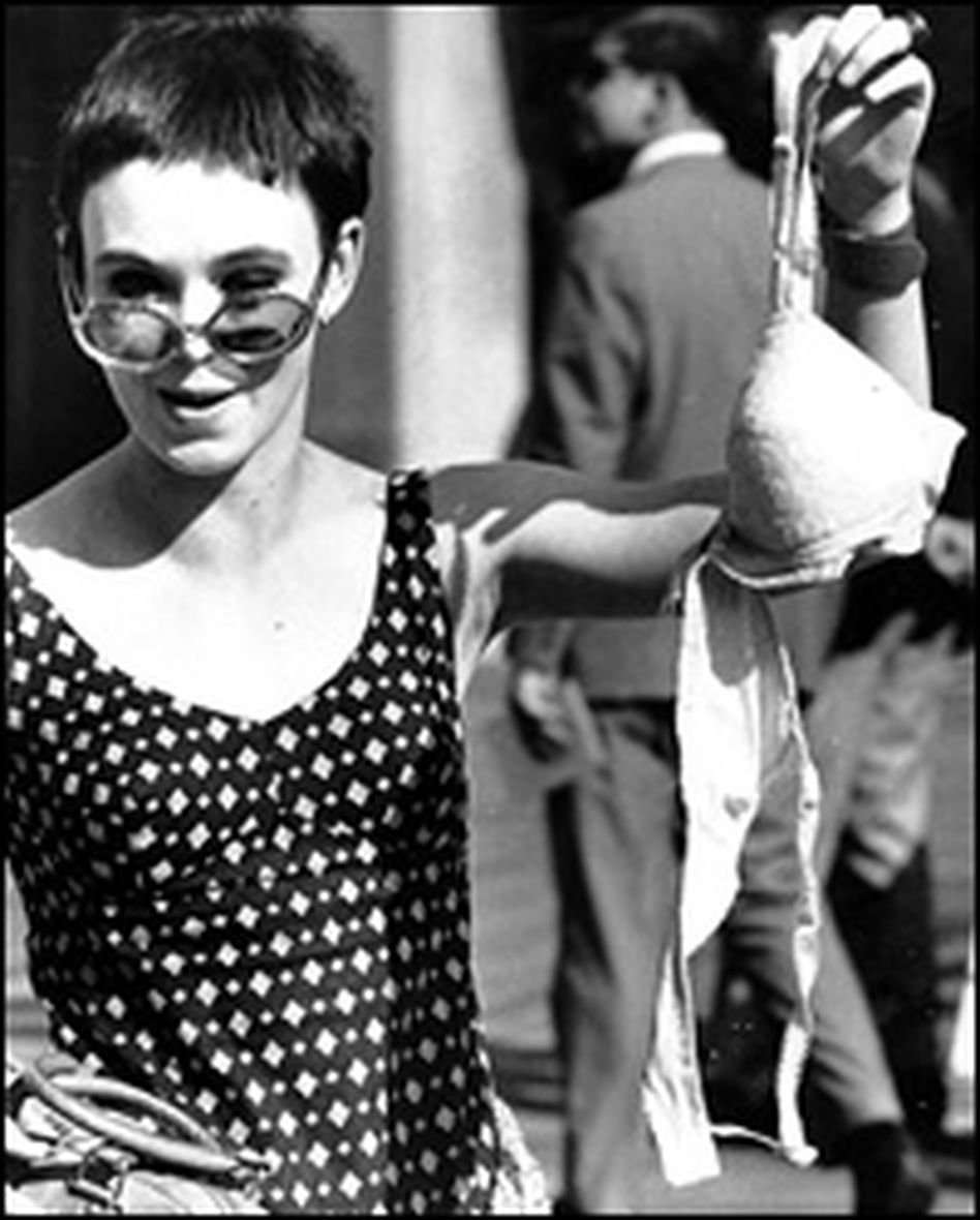 An unidentified protester drops a bra into the trash. The women did not burn their undergarments, contrary to popular belief.