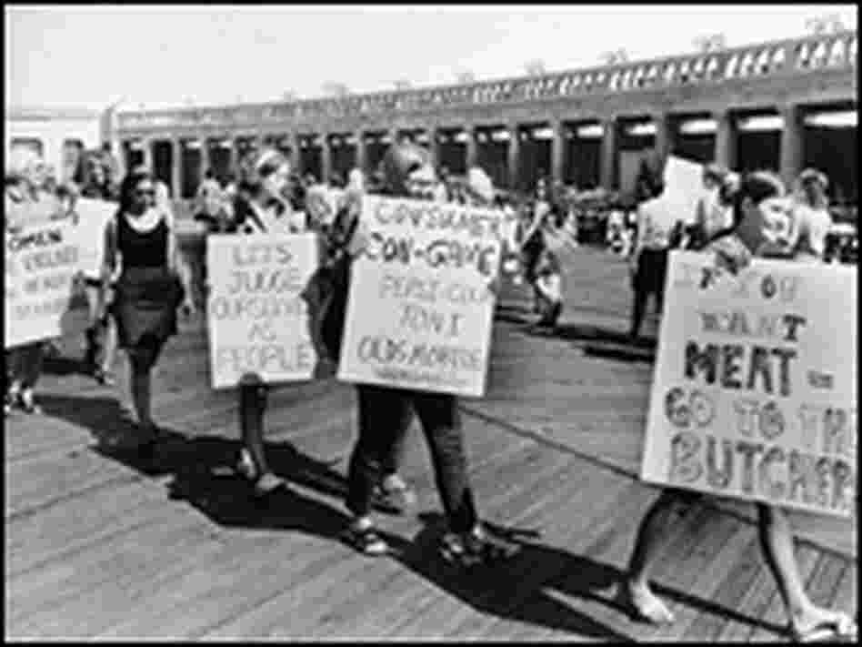Demonstrators from the National Women's Liberation Party picket with signs