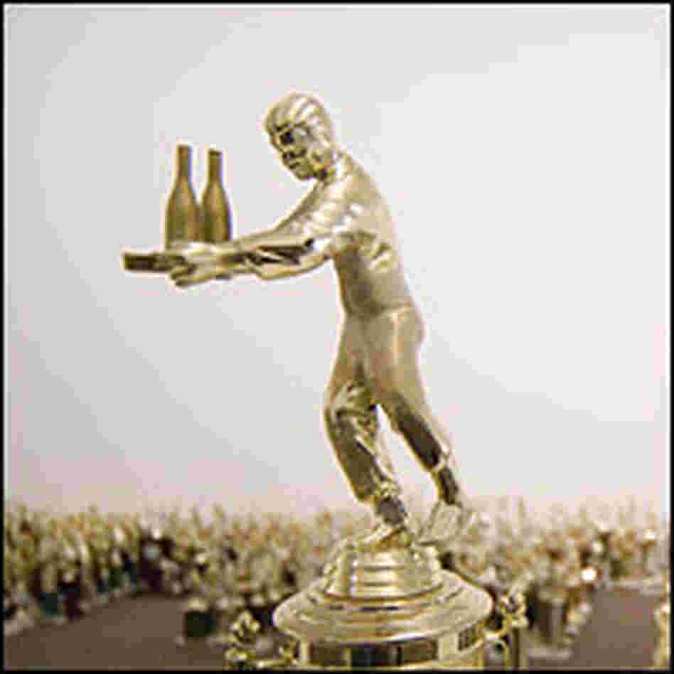 Trophy figure serving a tray with bottles