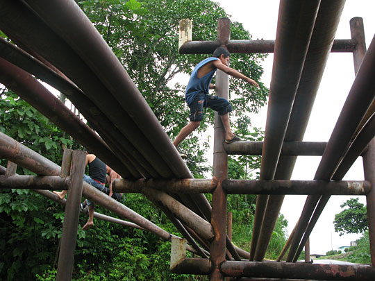 Children now use oil pipelines as makeshift jungle gyms.