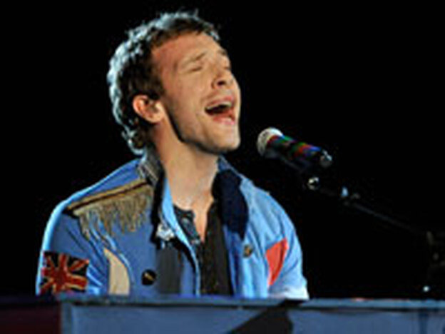 Coldplay's Chris Martin performing at the Grammys. Coldplay won three awards, including song of the year.
