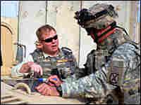 David Kilcullen (left) was counterinsurgency adviser to Gen. David Petraeu