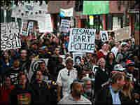 Demonstrators protesting BART shooting