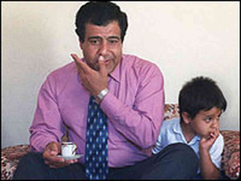 Dr. Izzeldin Abuelaish and his son Muhammed sit at his home in the Gaza Strip in this 2001 photo.