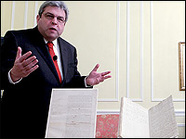 Marvin Pinkert, executive director of the National Archives Experience, displays several original documents regarding the presidential oath of office.