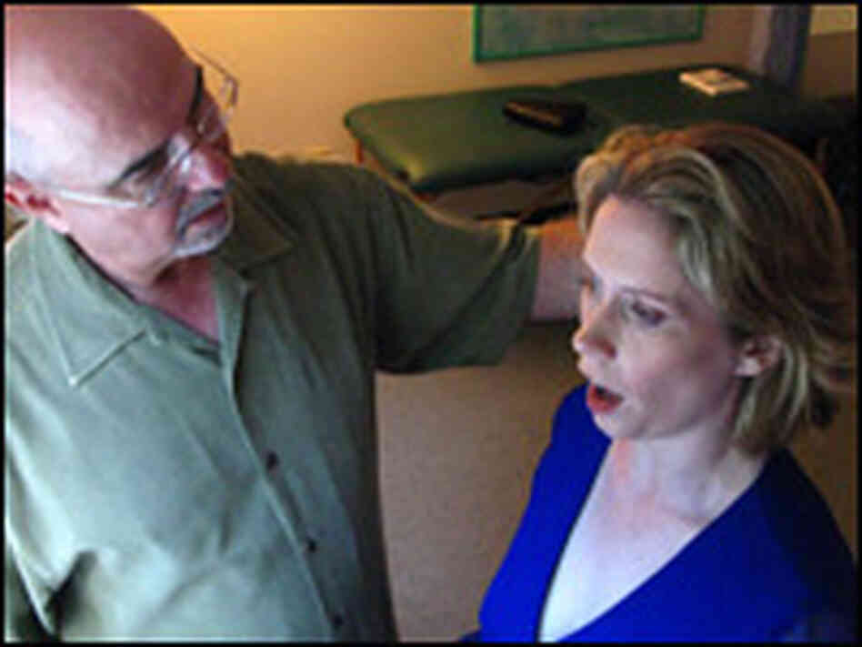 Teacher Edward Bilanchone instructs Soprano Alexandra Phillips in breathing technique