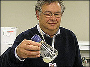 Jerry Sadoff, of Aeras Global TB Vaccine Foundation, holds a beaker of bacteria