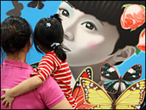 Visitors admire artwork on display at the SH contemporary art fair