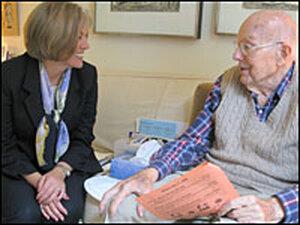 Patient advocate Dianne Savastano checks in with Bob Eckhoff in Brookline, Mass.